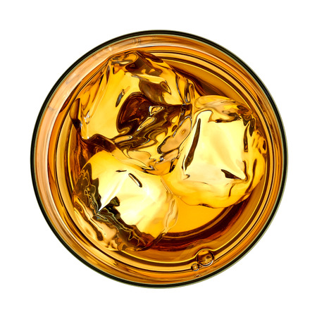 Whiskey with ice in glass from top on white background