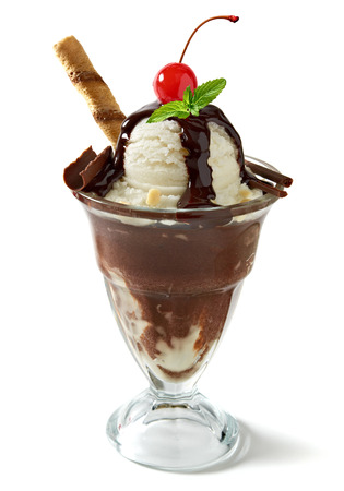 vanilla ice cream: Vanilla ice cream with sauce, wafer, sweet cherry, mint and chocolate curls in cup Stock Photo