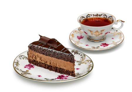 cake plate: Chocolate cake and tea in antique porcelain cup on a white background.