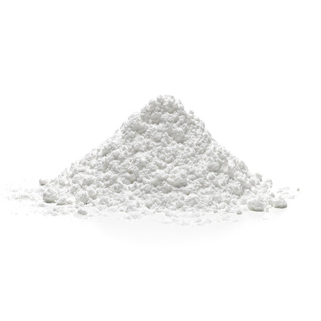 Icing sugar pile on white background.