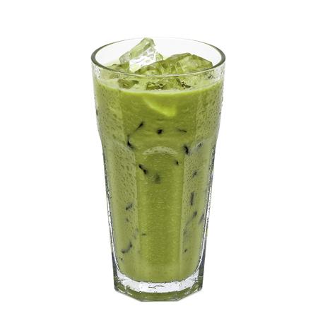 白い背景に分離された背の高いグラスにアイス抹茶ラテ 写真素材