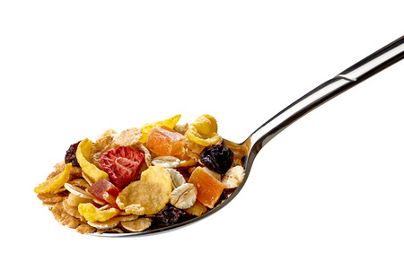 Muesli in spoon on white banckground including clipping path
