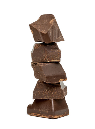 spall: Chocolate pieces on white background stack Stock Photo