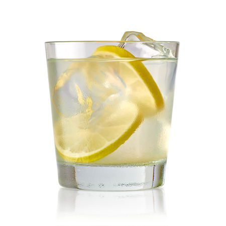 lemon slice: Vodka Lime, gimlet or gun tonic with ice in glass on white background