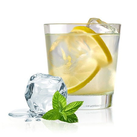 Vodka Lime, gimlet or gun tonic with ice in glass on white background