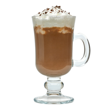Latte with cream in irish coffee mug on white background