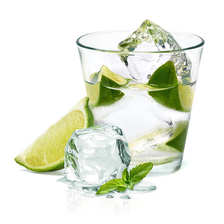 Caipirinha cocktail with lime wedge isolated on white background Stock Photo