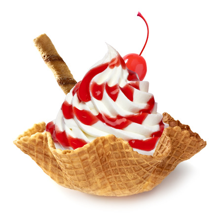 cream color: Vanilla ice cream or frozen yogurt with strawberry sauce in wafer bowl on white background Stock Photo
