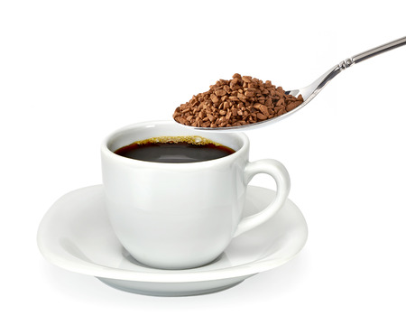 instant coffee: Cup of coffee with instant coffee in spoon Stock Photo