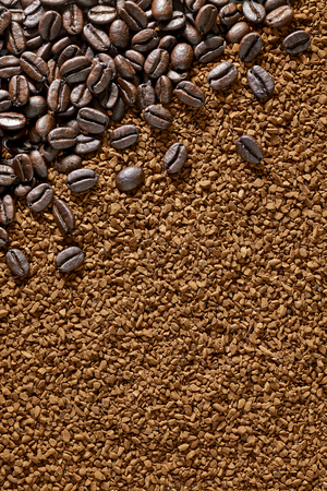 instant coffee: Coffee beans on instant granulated coffee Stock Photo