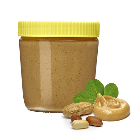 peanut butter and jelly sandwich: Peanut butter in jar with peanuts on a white background