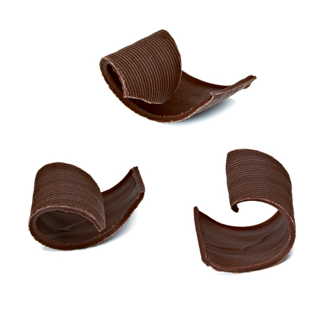 spall: Chocolate tablets with curls on a white background
