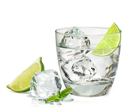 Tequila in rocks glass with lemon on white background Imagens