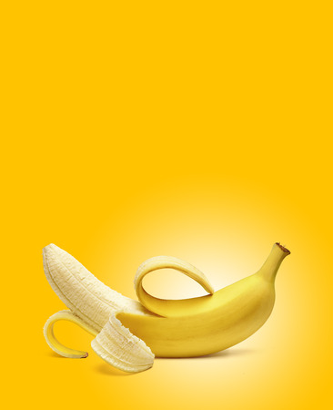 peeled banana: Peeled banana on yellow background Stock Photo