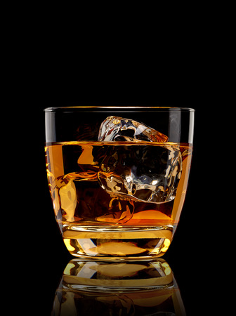shot glass: Whiskey with ice in glass isolated on white background Stock Photo