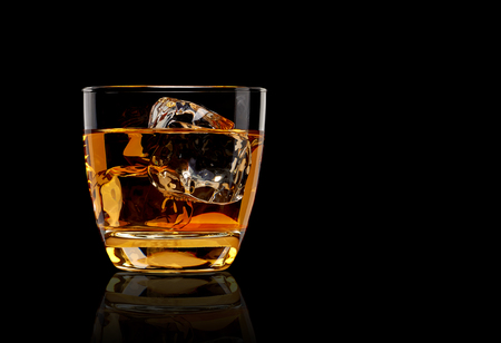 shot glass: Whiskey with ice in rocks glass isolated on white background