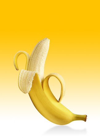peeled banana: Peeled banana on yellow background with copy space