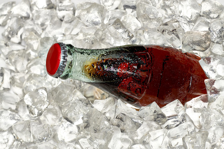 crushed ice: Cola bottle in crushed ice