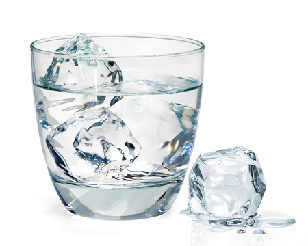 Glass of water with ice on white background