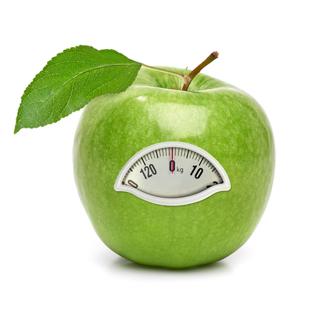 Green apple with weight scale on white background Stock Photo