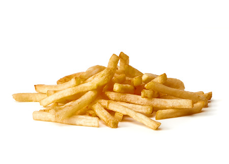 French fries on white background pile