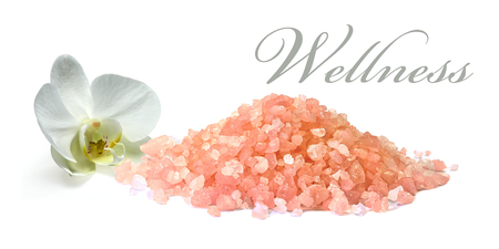 Himalayan salt pile with orchid on white background