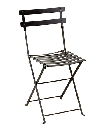 Wrought iron folding chair on a white background