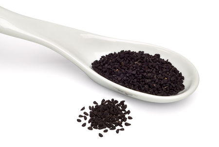 nigella seeds: Black seed, Nigella sativa seeds on a white background