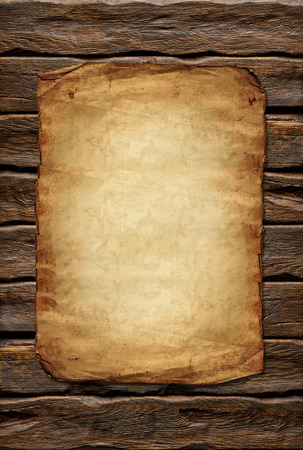 Old paper on wooden background with copyspace Stock Photo