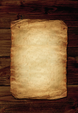 Old paper on wooden background with copyspace