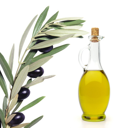italy culture: Detail olive brunch with oil bottle on white background Stock Photo