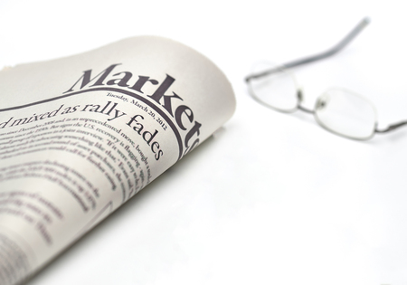 Economy newspaper with copy space on white background in shallow depth of field
