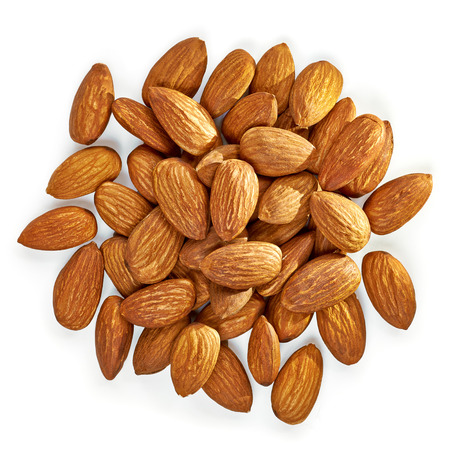 Almonds pile from top on white background.