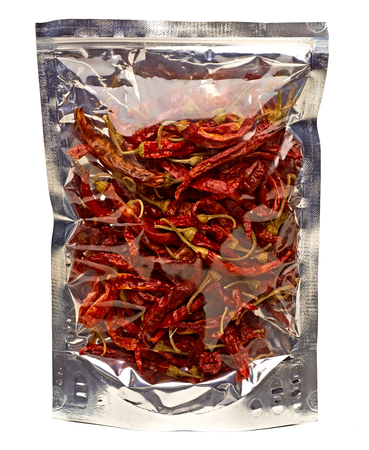 spicy food: Pimienta roja dried red chili peppers in pack on white background Stock Photo