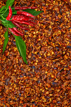 crushed red peppers: Fresh pimienta roja crushed red peppers on pepper background