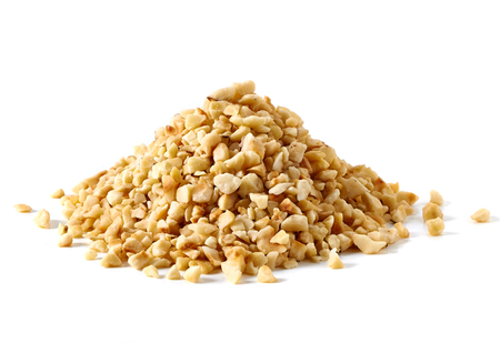 Diced hazelnuts pile on white background