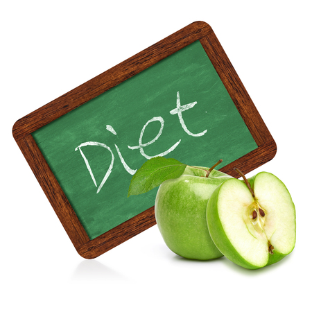 regimen: Green apple with diet chalkboard sign on a white background Stock Photo