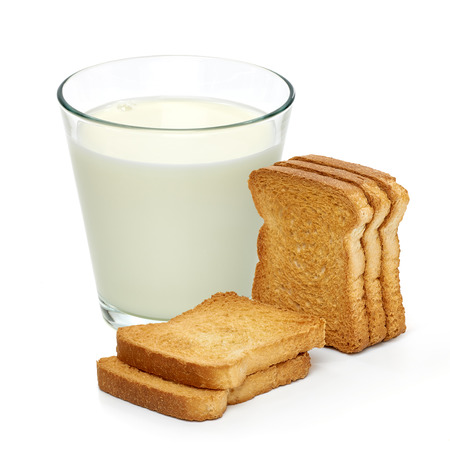 rusk: Rusk bread with glass of milk on white background