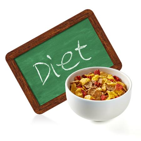 heathy diet: Muesli with diet chalkboard sign on a white background Stock Photo