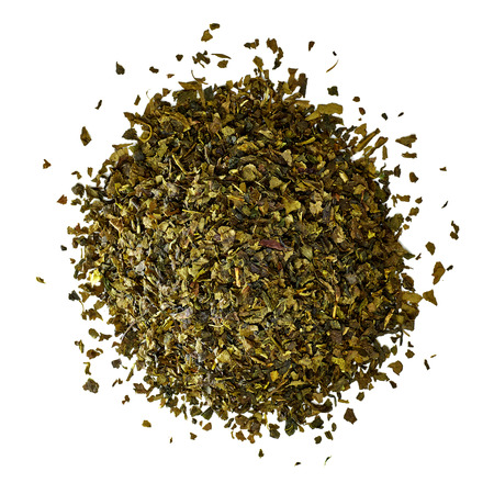 nutritional supplement: Dried green tea leaves on white background