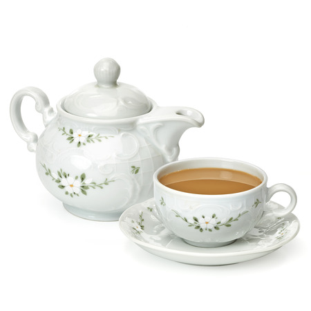Milk cup of tea with tea pot on a white background 스톡 콘텐츠