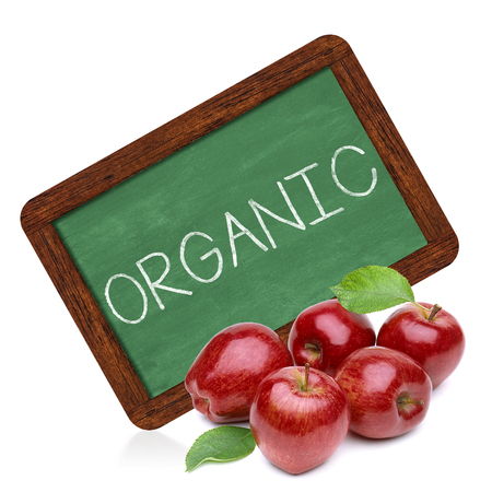 regimen: Organic apples with sign on a white background