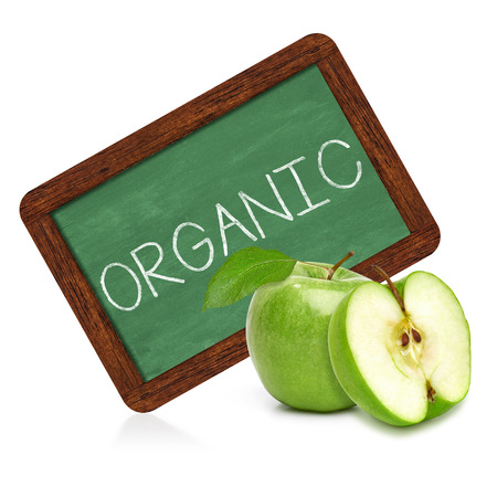 regimen: Organic apple with green chalkboard sign on a white background Stock Photo