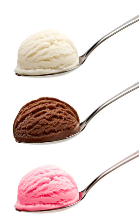 Strawberry, vanilla and chocolate ice cream in spoons on a white background