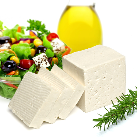 white cheese: Olive oil with salad and feta cheese on white background