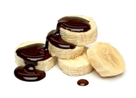 platano maduro: Salsa de chocolate en Rebanadas del pl�tano Foto de archivo