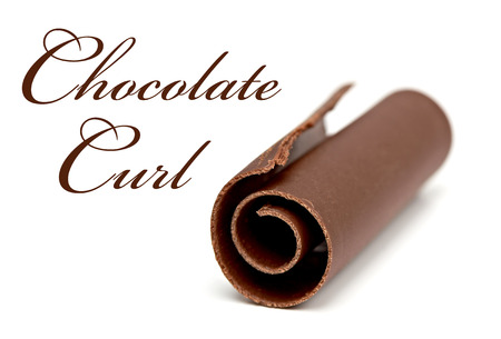 spall: Chocolate Curl with shallow depth of field on white background Stock Photo