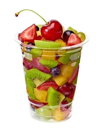 Takeaway cup of fruit salad on white background 免版税图像