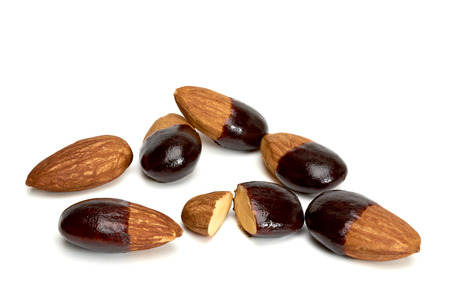 almond: Dipped in Dark Chocolate Almonds On White Background