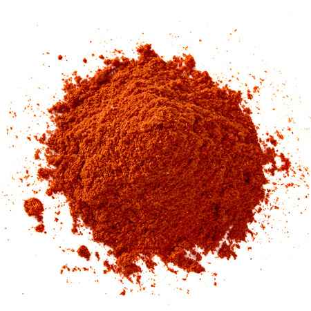 ground: Powdered red pepper pimienta roja battery from balls on white background Stock Photo